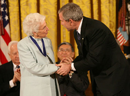 President George W. Bush congratulates Ruth Colvin after presenting her with the Presidential Medal of Freedom. Ruth's pioneering work in literacy became an early WTB project. White House photo by Eric Draper